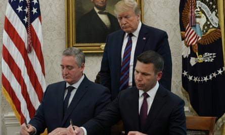 The acting US homeland security secretary, Kevin McAleenan, and the interior minister of Guatemala Enrique Degenhart sign an agreement in the Oval Office, 26 July 2019.
