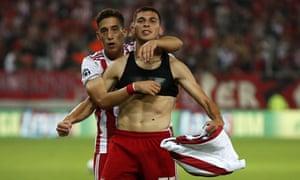 Olympiakos' Lazar Randelovic, right, celebrates after scoring his side's third goal.