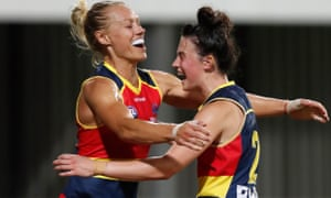 Erin Phillips and Eloise Jones celebrate during the match between the Adelaide Crows and the Fremantle Dockers at TIO Stadium.