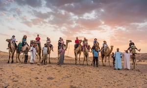 the group on a sunset camel ride near Aswan.