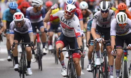 Alexander Kristoff celebrates as he crosses the finish line to win the first stage of the Tour de France in Nice