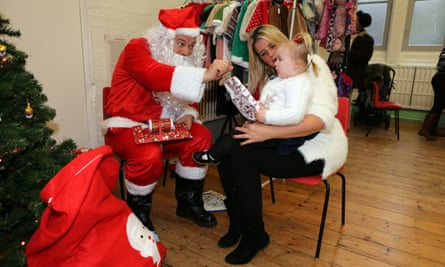 Vicky Jones and daughter Isla meet Father Christmas at the Balham party.