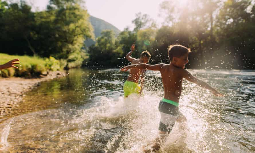 Boys spending summer day on the river
