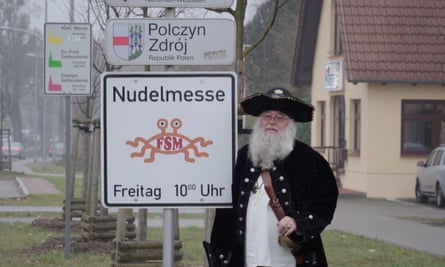 Bruder Spaghettus, a leading German Pastafarian, by a 'noodle mass' sign in Templin outside Berlin