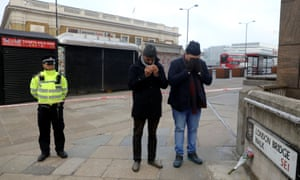 Sabah Ahmedi and Mansoor Clarke, imams of the Ahmadiyya Muslim Community, pray to mourn the victims at the scene of a stabbing on London Bridge.