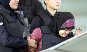 Siti Aisyah (right) leaves court in Malaysia