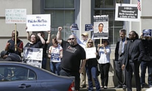 Opponents of HB2 protest across the street from the North Carolina state capitol in Raleigh on Monday during a rally in support of the law.