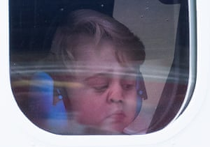 Prince George presses his nose against the seaplane window as the family leaves Victoria