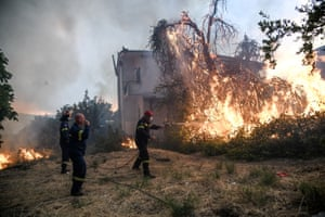 Evia, Greece Firefighters try to extinguish a wildfire near the village of Kontodespoti