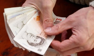 Cash in hand ... counting £10 notes.