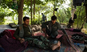 Afghan National Police rest at the camp they made near Talowka, north of the city of Kunduz in northern Afghanistan.