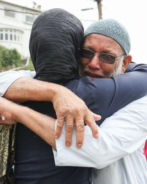 Jacinda Ardern comforts a mourner at Kilbirnie mosque in Wellington