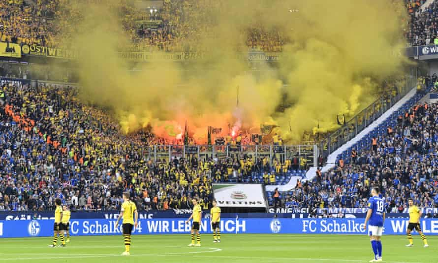 Dortmund fans burn yellow fireworks in the last Revierderby played in front of fans in October 2019.
