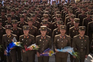 Korean People's Army soldiers wait to pay their respects before the statues of the late North Korean leaders Kim Il-sung and Kim Jong-il at Mansu Hill in Pyongyang.