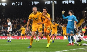 Romain Saiss celebrates his late equaliser at Craven Cottage.