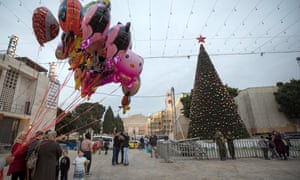 Christmas in Bethlehem: a Palestinian man sells balloons in Manger Square.
