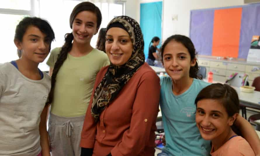 Nadira Hussein with her students at Max Rayne Hand in Hand school