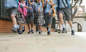 School children running.
