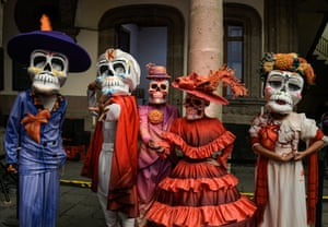 Mexico City, Mexico. Volunteers pose during a press conference to announce the International Day of the Dead parade at the Museum of Mexico City