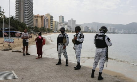 Members of Mexico's national guard keep watch on 2 July during the reopening of the beaches and hotels in Acapulco.
