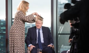 A stylist prepares Boris Johnson to appear on the Andrew Marr show before the Conservative party annual conference in September.