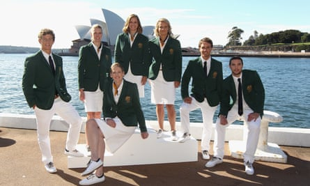 Australian team members pose during the official unveiling of the Australian 2012 Olympic Games opening ceremony uniform at Quay restaurant in Sydney.