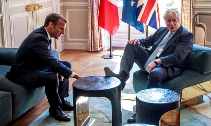 Boris Johnson puts foot on table