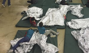 Child migrants rest in one of the cages at a facility in McAllen, Texas, in this 17 June photograph provided by Immigration and Customs Enforcement.