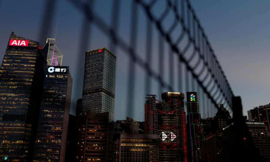 Skyscrapers behind a fence in Hong Kong's CBD
