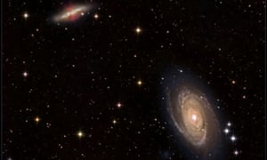 """This image shows M81 (bottom right) and M82 (upper left), a pair of nearby galaxies where """"intergalactic transfer"""" may be happening. Gas ejected by supernova explosions in M82 can travel through space and eventually contribute to the growth of M81."""