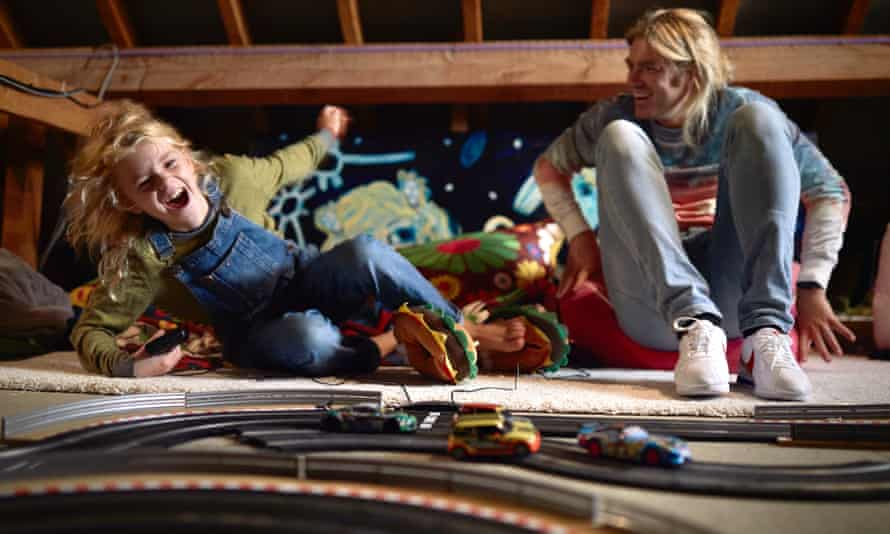 Ben Martin and son Phoenix playing on the 75ft Scalextric track in their loft.