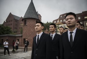 Huawei security guards line up at the end of their work day