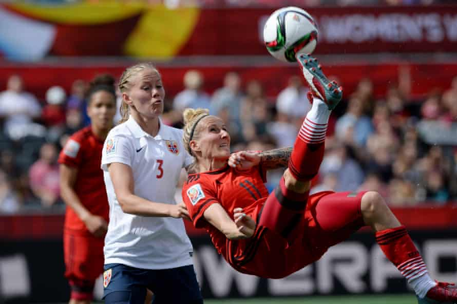 Germany's Anja Mittag tries an overhead kick as Norway's Marita Skammelsrud Lund defends during the first half of their FIFA Women's World Cup match in 2015.