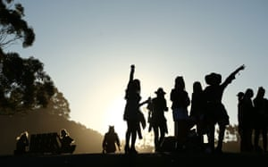 Festivalgoers watch the sunset.