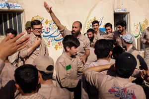 The man who supervises the young Basij people, with his arm raised, is called Jaber