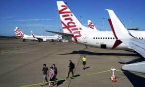 Passengers prepare to board a Virgin Australia flight.