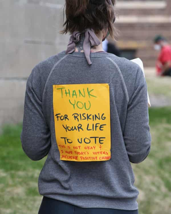 person wears sign saying thank you for risking life to vote