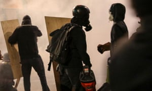 Protesters with shields use leaf blowers to diffuse teargas in Portland