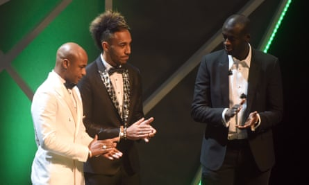 Yaya Touré, right, and André Ayew applaud Gabonese striker Pierre-Emerick Aubameyang after the Dortmund striker was voted winner of the African Footballer of the Year award in Abuja.
