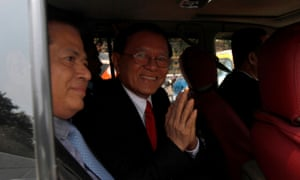 Kem Sokha leaving the municipal court after the start of his trial on Wednesday