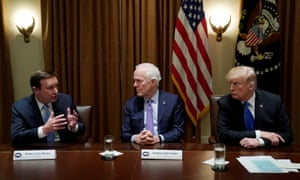 Senator Chris Murphy of Connecticut, Senator John Cornyn of Texas and Donald Trump during a bi-partisan meeting with members of Congress to discuss school and community safety in the wake of the Florida school shootings at the White House on 28 February.