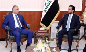 Iraq's newly appointed prime minister, Mustafa al-Kadhimi (L) , meets with speaker of Iraq's parliament Mohammed al-Halbousi (R) in Baghdad.