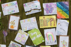 Some positive messages from local schoolchildren are pinned to a fence in Brighton.