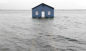 A boathouse on the Swan River sits in water in the Perth suburb of Crawley after a tidal surge from the remnants of Tropical Cyclone Mangga