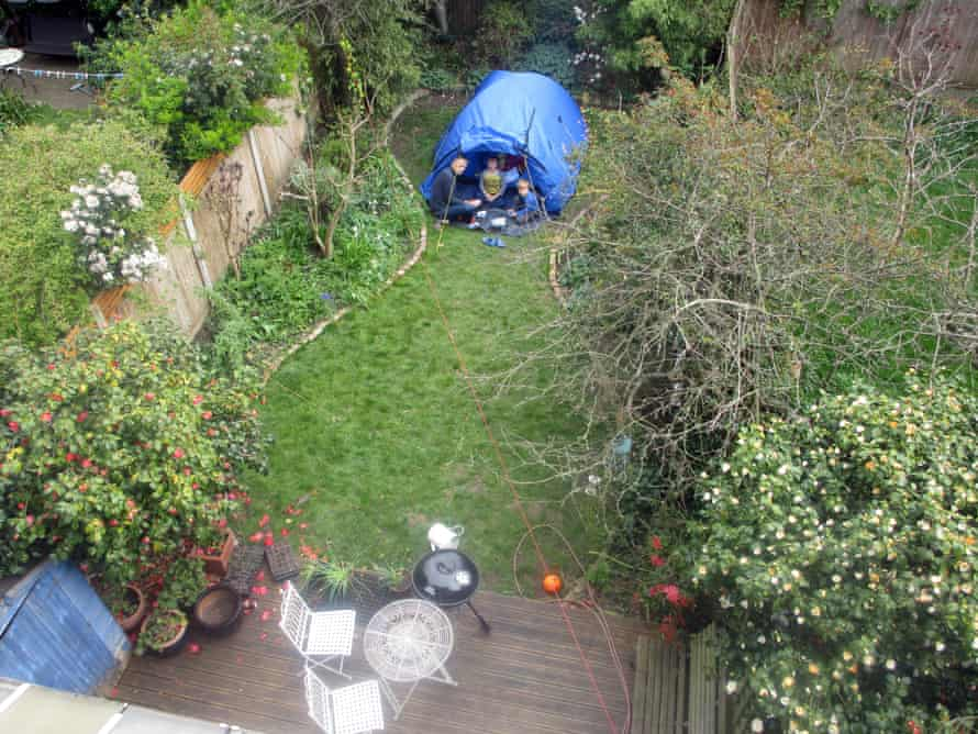 Sam Wollaston and sons camping in their back garden.