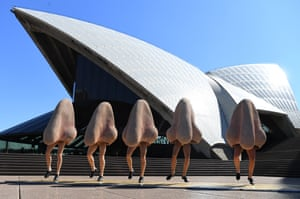 Opera Australia cast members dance in costume outside the Sydney Opera House, during a preview of their production of Shostakovich's The Nose