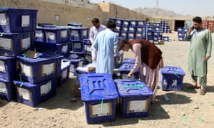 Election workers move ballot boxes to an Independent Election Commission warehouse on Sunday.