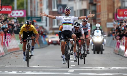 Julian Alaphilippe celebrates but Primoz Roglic (in yellow) was the winner at the Liège-Bastogne-Liège classic.
