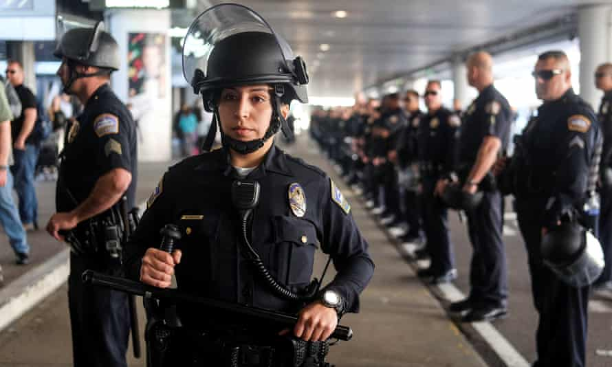 Police officers stand guard at Los Angeles international airport.