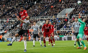 Everyone watches the ball as Divock Origi's winner, deflected of Jamaal Lascelles, beats Martin Dubravka in the Newcastle goal